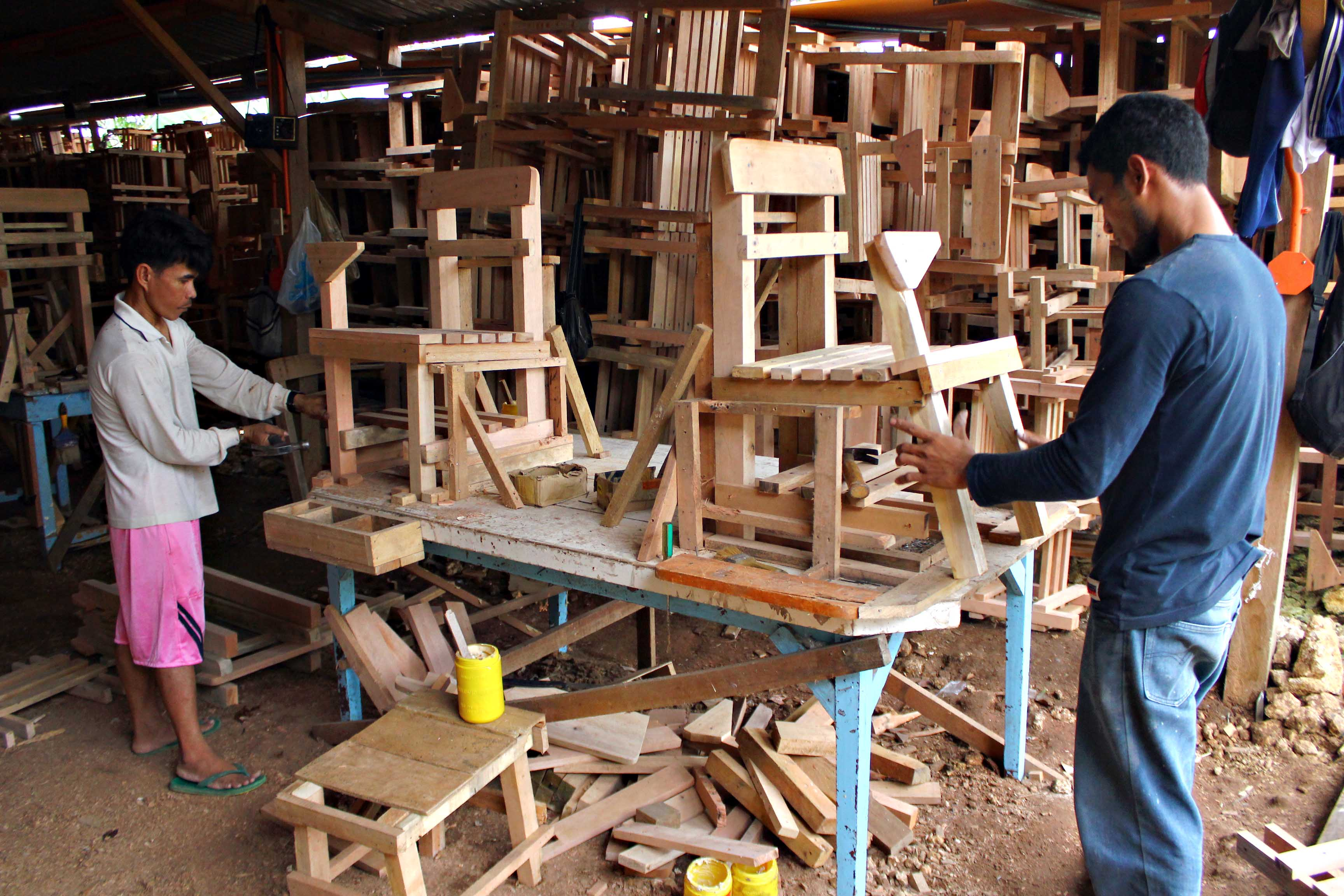 illegal lumber transformed to desks